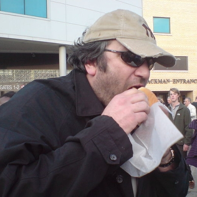 He may be in disguise, but his burger eating technique is unmistakable.